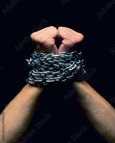 Rised up chained hands