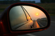 Sunset in mirror of car