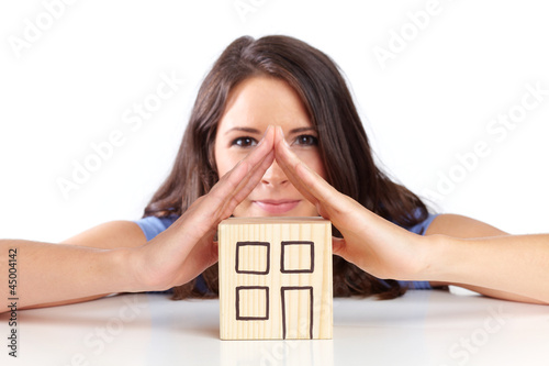 Young woman illustrates a roof with hands