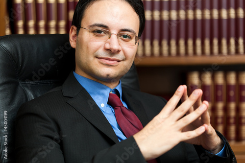 Successful lawyer sitting in his studio