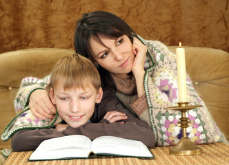 Luck nice Caucasian mom with her son reading a book