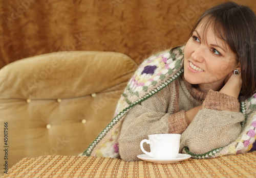 Nice Caucasian woman on a sofa