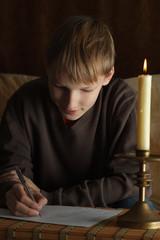 Pretty Caucasian boy sitting at a table