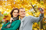 young people Couple at autumn outdoors