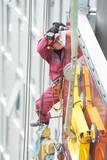 builder joiner installing glass window on building poster