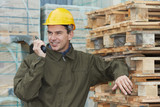 happy warehouse worker with radio transmitter