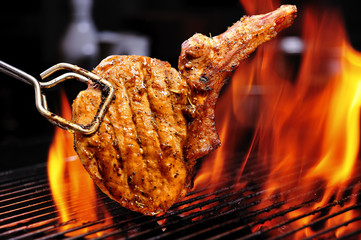 grilled pork steak on the grill
