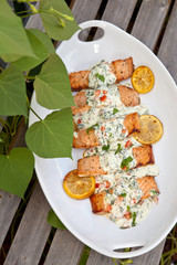 Cooked salmon fillets with spinach sauce