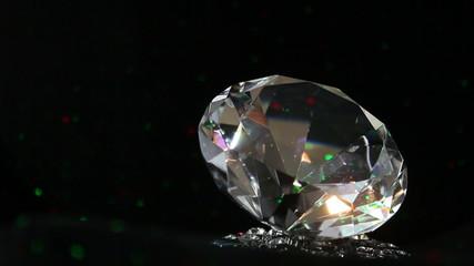 single sparkling diamond, turning