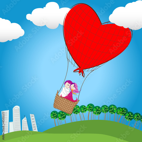 Cute couple in love flying away on a hot air balloon