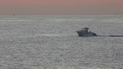 Motor boat sailing on the sea at dawn