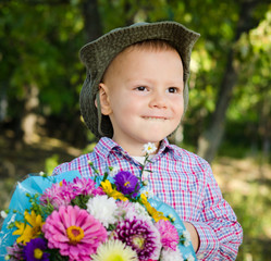 Little boy with flowers for his sweetheart