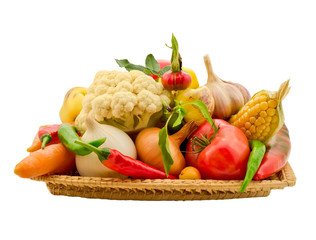 composition of vegetables in a basket isolated on white backgrou