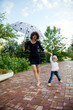 Happy smiling mother and daughter with umbrella