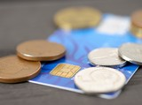 Macro shot of old blue credit card with Czech coins (crown).