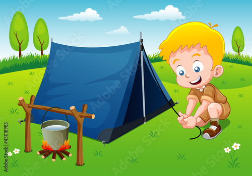 Boy scout camping with camping tent