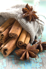 Cinnamon and anise in a small burlap sack