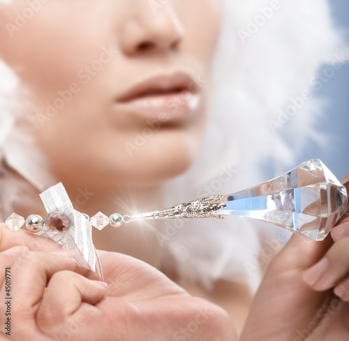 Closeup photo of crystal gem held by woman