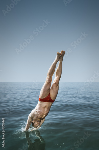 man jumping in the lake