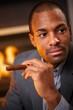 Portrait of handsome black man with cigar