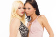 Sexy lesbian couple on white isolated background