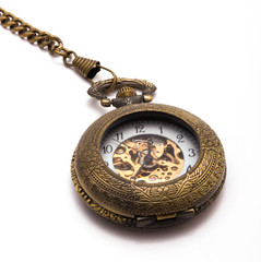 Closed pocketwatch on a white background