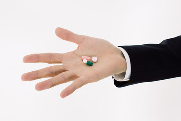 pills  on man's hand