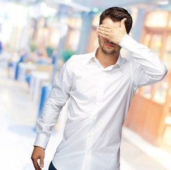 Portrait Of An Businessman Covering Eyes