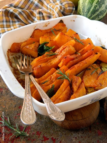 Baked pumpkin with sage and rosemary