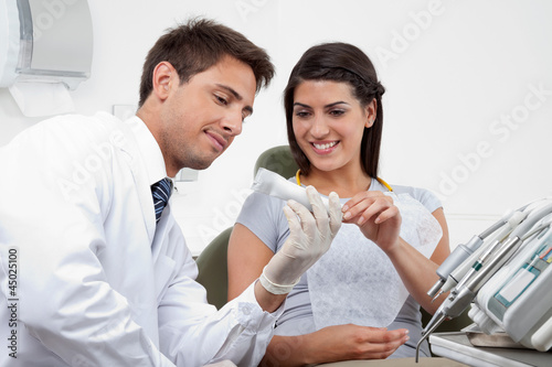 Dentist Prescribing Tooth Paste To Patient