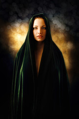 Inspired beautiful woman covered with green mantle