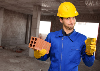 Engineer Holding Brick And Gold Bar