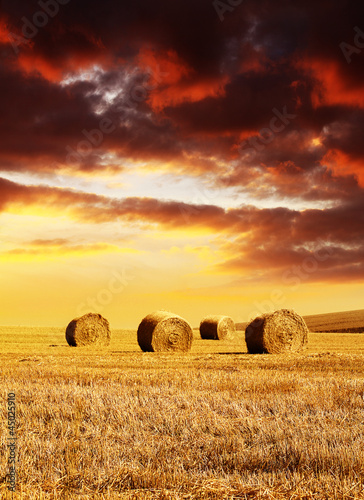 sunset over hay bales