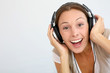 Cheerful woman with headphones, isolated