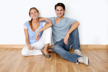 Couple sitting on the floor in new apartment