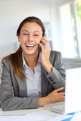 Businesswoman on the phone laughing outloud