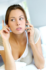 Portrait of woman receiving bad news on the phone