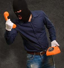Burglar Man Holding Telephone