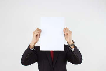 men holding white paper