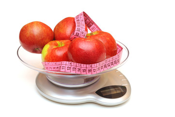 Kitchen scale, apples and measuring tape