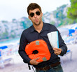 Man Standing With Boarding Passes And Bag