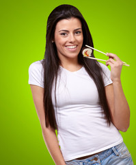 Portrait Of A Female Holding A Maki Sushi