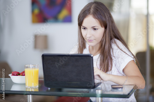 Cute woman working from home