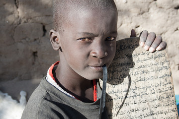 Boy showing his Arabic manuscript, Timbuktu, Mali.