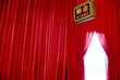 stage entrance with red screen curtain