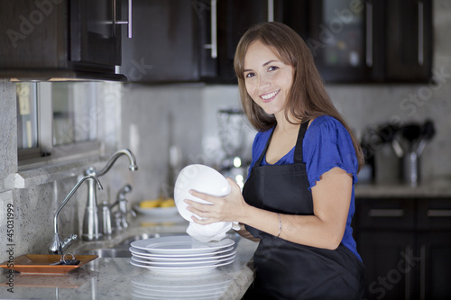 Cute housewife drying some dishes
