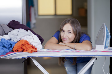 Cute woman unhappy about all the house chores