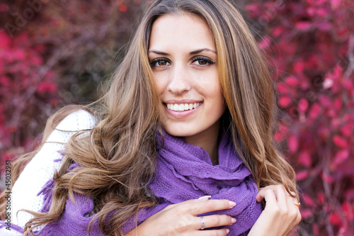 portrait of beautiful girl in autumn leaves.