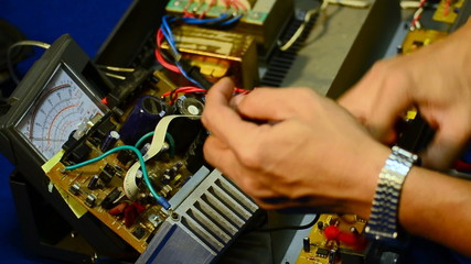 electrician using voltmeter for checking and repair