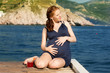 Young pregnant woman on a beach